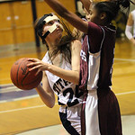 Lorain's Onyx Lopez is fouled while shooting by Maple Heights Danielle Robinson. photo by Ray Riedel