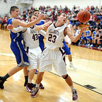 Wellington 23 Dave Clark grabs a rebound and puts up a shot next to teammate 43 Tim Young and Midview's Tyler Pasenow in first half Dec. 4. Steve Manheim