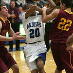 Midview's #20 DJ Johnson hooks elbows with Avon Lake's #22 Logan Dilik. .  photo by Chuck Humel