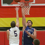 Midview's #34 Riley Moore defends against a shot by North Royalton's #5 Brandon Woods.   photo by Chuck Humel