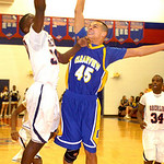 Clearview's #45 Aaron Arnoczky blocks Oberlin's #30 Dominic Taylors shot.