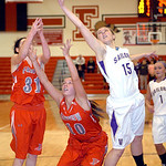 Vermilion's #15 Jennifer Kovarik reachs to grab the rebound from Fairview's #31 Megan Coyne and #10 Kaitlyn Smith.