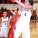 Vermilion's #4 Andrea Dillon fights Fairview's #24 Rachel Malloy for the rebound.