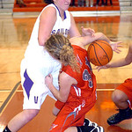 Vermilion's #4 Andrea Dillon fights Fairview's #31 Megan Coyne for the ball.