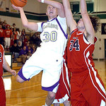 Vermilion's #30 Cameron Kuhn goes up for a basket past Firelands' #34 Joseph Hyster.