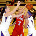 Vermilion's #24 Ellen Rossi and #33 Ali Kowal fight Huron's #2 Audra Wisehart for the ball.