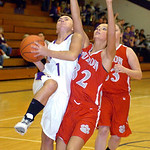 Vermilion's #1 AuBree LaForce goes up for a basket past Huron's #32 Morgan Welborn.