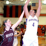Vermilion's #4 Andrea Dillon shoots past Rocky River's #10 Carolyn Farling.