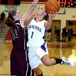 Vermilion's #1 AuBree LaForce shoots past Rocky River's #10 Carolyn Farling.