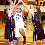 Vermilion's #33 Ali Kowal tries to shoot past Rocky River's #4 Annie Swartz and #10 Carolyn Farling.
