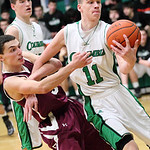 Wellington's Dave Clark fouls Columbia's Jacob Simon (11) as he steals the ball. photo by Ray Riedel