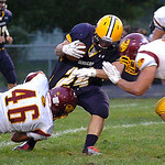 Avon Lake's Collin Lucas and Max Seipel stop North Ridgeville's CJ Osbourne. Linda Murphy/Chronicle