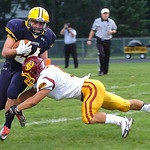 North Ridgeville's CJ Osbourne tries to get around Avon Lake's Wyatt Ohm. Linda Murphy/Chronicle