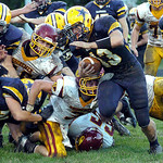 Rangers quarterback Jason Lucas runs for yardage past Avon Lake's Trevor Anderson. Linda Murphy/Chronicle
