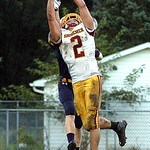 Avon Lake's Max Seipel catches a touchdown pass as Bailey Gannon defends.  Linda Murphy/Chronicle
