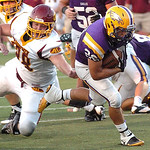 Avon's Gerett Choat runs for endzone past Avon Lake's Kyle Kuhar. Photo by Linda Murphy