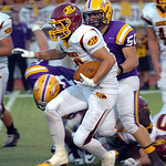 Avon Lake's Jeremiah Campo runs for yardage past Avon's Domonic Bodnar. Photo by Linda Murphy