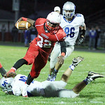 ANNA NORRIS/CHRONICLE Elyria's Jordan Connell avoids the tackle of Midview's Tyler Lienerth and carries the ball for the first down in the second quarter last night at Ely Stadium in Elyria.