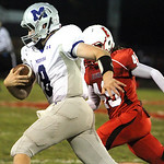 ANNA NORRIS/CHRONICLE Midview quarterback Cody Callaway runs the ball to the outside on a quarterback keeper against Elyria in the second quarter last night at Ely Stadium in Elyria.