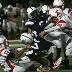 Elyria's #12 Tavon Kurtz and #31 Tony Cassity pull down a Valley Forge runner.