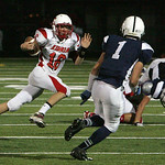 Elyria QB Zach Minney running out of the pocket.