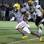 ANNA NORRIS/CHRONICLE Avon running back Antonio Orr runs the ball up the field on a kick-off return for the first down against Elyria Catholic in the second quarter Friday night at Avon Stad …
