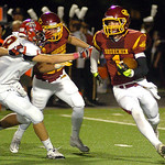 Avon Lake's Jace Russell runs around Brecksville's Matt Zakelj for yardage. LINDA MURPHY/CHRONICLE