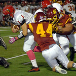 Avon Lake's Danny Disbrow, center, and Kyle Kuhar try to stop Brecksville quarterback Tim Tupa. LINDA MURPHY/CHRONICLE
