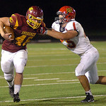 Avon Lake's Lucas Collin tries to push away Brecksville's Dylan Goodwin while running for yardage. LINDA MURPHY/CHRONICLE