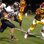 North Olmsted's Ryan Coleman tries to get past Avon Lake's David Winkel. LINDA MURPHY/CHRONICLE