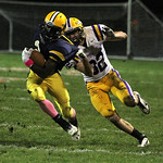 ANNA NORRIS/CHRONICLE North Ridgeville running back Demario McCall runs the ball up the field for a gain of yards as Avon's Mitch Tomlin goes in for the tackle in the second quarter Friday n …