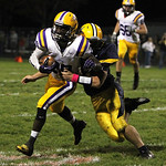 ANNA NORRIS/CHRONICLE Avon running back Antonio Orr runs the ball to the outside for a gain of yards as North Ridgeville's Jonah Bowden makes the tackle in the first half Friday night in Nor …