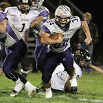 ANNA NORRIS/CHRONICLE  Keystone running back Tyler Polen runs the ball to the outside for a gain of yards against Black River in the first half Friday night at Keystone High School.