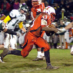 Elyria's Jumarr Lewis runs for yardage against Medina. LINDA MURPHY/CHRONICLE