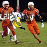 Elyria's Tavon Kurtz runs for yardage with the help of Elyria's Mike Church. LINDA MURPHY/CHRONICLE