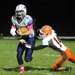 Keystone's Tyler Gullett breaks a tackle attempt by Buckeye's Nathan Polidori. STEVE MANHEIM/CHRONICLE
