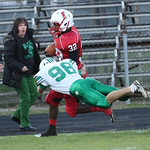 Elyria's Jordan Connell is pushed out of bounds on a diving hit by Mayfield's Patrick Tighe. Ray Riedel/Chronicle