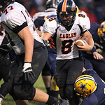 13SEP13_North Olmsted quarterback Brad Novak keeps the ball at North Ridgeville High School. photo by Ray Riedel