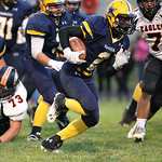 13SEP13_DeMario McCall finds a way through for a touchdown early in the 2nd quarter at North Ridgeville High School. photo by Ray Riedel