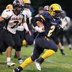 13SEP13_DeMario McCall sprints through for a touchdown early in the 2nd quarter at North Ridgeville High School. photo by Ray Riedel