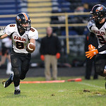 13SEP13_North Olmsted's Brad Novak hands off to Ben Kurcsak at North Ridgeville High School. photo by Ray Riedel
