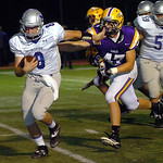 Midview quarterback Cody Callaway runs for yardage while trying to strong arm Avon's Kevin Maloney. LINDA MURPHY/CHRONICLE
