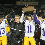 Avon's Braeden Friss holds up the Regional runner-up trophy as the team salutes their fans after dropping a close game to Highland 24-21. (RON SCHWANE / CT)