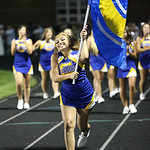 Angelina Carrion celebrates with the Clearview flag after another Clearview touchdown in the opening game against Vermilion. photo by Ray Riedel