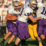 Vermilion RB Brandon Cole follows blocks by Tony Carreon (50) and Brenden Zannoni (10). photo by Ray Riedel