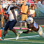 ANNA NORRIS/CHRONICLE Lorain running back Sherman Saunders runs the ball into the end zone on a two-point conversion against Midview in the second quarter Friday night at Midview High School …