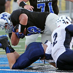 ANNA NORRIS/CHRONICLE  Midview running back Brett Zupancic dives over the Lorain defense for a gain of yards in the second quarter Friday night at Midview High School.
