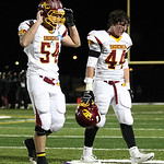 Avon Lake's Sam McKinley (54) and Danny Disbrow leave the field after being defeated by the Highland Hornets 28-21.. Photo by Aaron Josefczyk