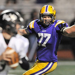 Michael Maxwell of Avon rushes the quarterback in the fourth quarter. DAVID RICHARD / CHRONICLE