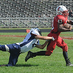 Elyria Jumarr Lewis breaks a tackle attempt by Valley Forge William Brown for a long gain on td drive in second quarter Sep. 21.  Steve Manheim